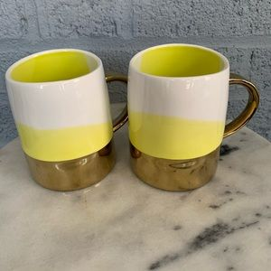 2 Anthropologie multicolored mugs with gold accent